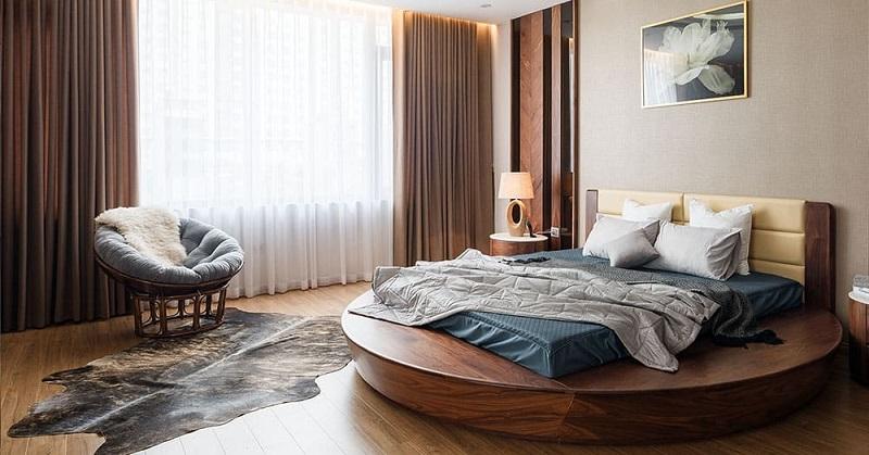 Giường ngủ dáng tròn, chất liệu gỗ óc chó